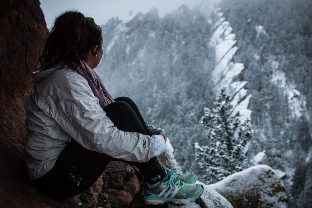 Girl looks out in winter, be present, be mindful, just be, being present.